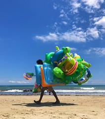 Untitled (marcus.greco) Tags: lifebuoys mats portrait beach sea sky