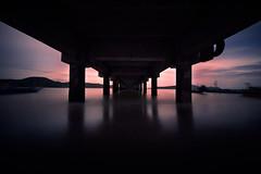 Useless (@_polod_) Tags: bridge ocean seascape landscape nd neutraldensity filter longexposure f22 water sunset dark silhouette