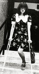 h5341-b100ft23  - The Platform shoe girl (jackcast2015) Tags: handicapped disabled disabledwoman cripledwoman onelegwoman oneleggedwoman monopede amputee legamputee crutches crippledwoman 1970s 1970sfashion