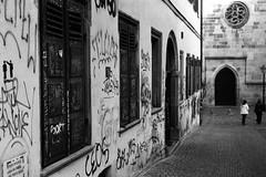 Shoot me again (Leica M6) (stefankamert) Tags: stefankamert street graffiti people tübingen noir noiretblanc blackandwhite blackwhite leica m6 leicam6 summicron dr dualrange kodak trix church city perspective lines tones