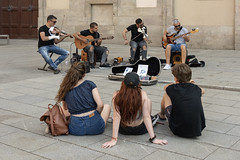 The concert (tmeallen) Tags: streetmusicians violinists guitarists concert gothicquarter barrigotic pavement seated listening longhair redhair twowomen man young barcelona catalonia spain placanova