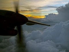Dashing Through the Evening 2008 (Greg Reed 54) Tags: sunset sunsets cloud clouds storms storm thunderstorm thunderstorms flight aviation dhc8 dash8 dusk aerial