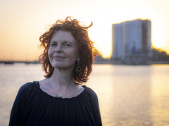 Hanneke, Sugar City 2018: Backlit curls (mdiepraam) Tags: hanneke sugarcity halfweg 2018 portrait pretty attractive beautiful elegant classy gorgeous dutch redhead woman lady naturalglamour curls bluetop mature milf sunset factory water sky backlight