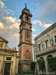 Bernascone's Bell Tower, Varese (mswan777) Tags: flag mobile iphone iphoneography apple square red blue world travel up italy varese brick history outdoor cloud sky tall city bell tower