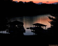 Boat Houses on Lake Anna at dusk (PhotosToArtByMike) Tags: sunset lakeannavirginia lakeanna boathouses docks dusk virginia va lake fredericksburg mineral landscape sunsetrays