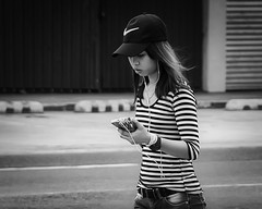 Connected (Beegee49) Tags: street filipina walking phone headphones nike cap bacolod city philippines allfreepicturesjuly2018challenge