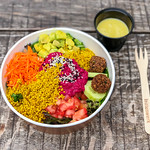 Rainbow Bowl: colorful spinach mix, avocado cubes, pink hummus, falafel, cucumber slices, quinoa, carrot stripes, tomato cubes, dressing thumbnail