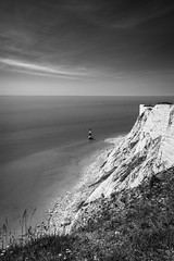 Beachy Head (Lloyd Austin) Tags: blackwhite beachyhead calm eastbourne eastsussex uk lighthouse lightroom grass cliffs chalkcliffs reflecting light exposure beach sand sea seascape sky shoreline stones clouds tide englishchannel black white water grey vista view seaview landscape land england horizon shore coastline coastal coast chalk contrast composition texture seaside summer sigma sigma1750mm dramatic d7200 day nikon nature southdowns southernengland tripod bnw bw mono monochrome