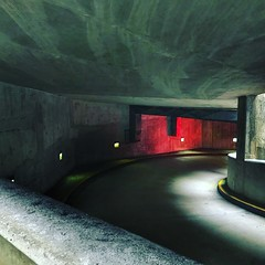 Parking Garage (Beth Reynolds) Tags: garage parking concrete red light curves city urban path exit linescurves