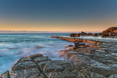 Sunrise and Rock Platform by the Sea (Merrillie) Tags: daybreak sand sunrise rocky rocks nature water blueskies surf centralcoast wamberal weather newsouthwales waves earlymorning nsw morning beach ocean sea sky landscape coastal waterscape outdoors seascape dawn coast australia seaside forrestersbeach