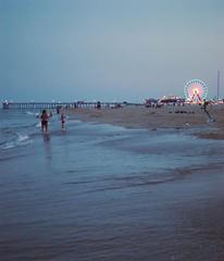 Dusk in the water (ryandoddlol) Tags: trip roadtrip holiday vacation amusementpark fair wheel ferris ferriswheel reflection night pier beach sand waves ocean water
