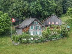 Swiss house (sander_sloots) Tags: house huis farm boerderij obstalden mürtschenstock berghuis haus swiss zwitserland switzerland flag vlag