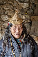Old Layap woman in her house - Laya - Gasa District - Snowman Trek - Bhutan (PascalBo) Tags: nikon d500 asie asia southasia asiedusud drukyul drukgyalkhap bhutan bhoutan འབྲུག་ཡུལ། འབྲུག་རྒྱལ་ཁབ་ snowman trek trekking hike hiking lunana gasa himalaya himalayas jigmedorjinationalpark laya layap people woman femme hat chapeau portrait indoor indoors pascalboegli indigenous