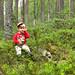 boy having a break in the forest