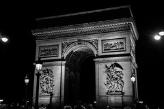 The Arc de Triomphe by night.