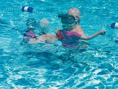 Cooling Off (Mildred Alpern) Tags: pool water rope figures man child ripples buoys swirls doubleexposure floatline