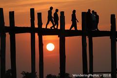 Sunset under U Bein Bridge - Amarapura Mandalay Myanmar (WanderingPJB) Tags: myanmar burma mandalay amarapura ubeinbridge sunset people walking silhouette 7dwf crazytuesdaytheme sunmoonorstars cmwdorange wooden teak colourfulworld