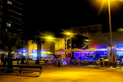 Badaloneando: I need a beer (Fnikos) Tags: street city light building store shop bar café restaurant bench table seat people tree palmtree nature nightview nightshot outdoor