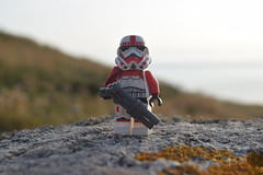 Shocktrooper Captain on the Headlands. (Working hard for high quality.) Tags: toy lego minifigure star wars stormtrooper shocktrooper galactic empire plastic rock stone grass sunset sky lighting trooper soldier nature