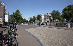 Amsterdam. (alamsterdam) Tags: amsterdam keizersgracht canal bridges water architecture sky bikes people