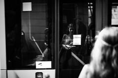 Penumbra 289 365 (ewitsoe) Tags: canoneos6dii city europe ewitsoe spring warszawa erikwitsoe poland urban warsaw mono monochrome woman speedingtram bus metro standing halfshadow bnw blackandwhite