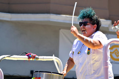 Carnaval Parade SF 116 (TheseusPhoto) Tags: colors colorsoftheworld costume parade carnaval carnaval2018 carnavalsf people candid streetphotography street celebration drummer sunglasses stick smile laugh hair