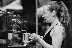 Coffee Maker (Ian Sane) Tags: ian sane images coffeemaker woman latte barista spunkymonkeycoffeeroasters portlandfarmersmarket portlandstateuniversity portland oregon black white monochrome candid street photography canon eos 5ds r camera ef100400mm f4556l is usm lens