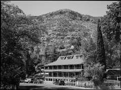 The Inn At Castle Rock (greenschist) Tags: trees usa zenzanonrf65mmf4 analog 6x45 cochisecounty mediumformat film mountains blackwhite arizona theinnatcastlerock bronicarf645 bisbee ilforddelta100