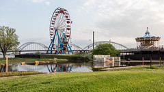 Don't Let a Little Water Spoil the Party (string_bass_dave) Tags: merrygoround davenport bridge ferriswheel carnival iowa amusement reflect water unitedstates us flickr