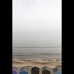 Beach Huts (JoshJackson84) Tags: canon60d sigma18250mm europe uk england hampshire newforest milford milfordonsea beachhuts hut huts vertical beach sea waves haze hazy