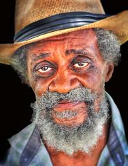 Singing for his supper ... (daystar297) Tags: streetportrait portrait man face africanamerican black musician performer artist beard elderly hat eyes soul heart kind nikon fortpierceflorida