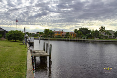 PGI--A Network of Canals (SteveFrazierPhotography.com) Tags: canal landscape seascape seawall dock homes houses flag shoreline water waves puntagorda pgi puntagordaisles charlotteharbor peaceriver charlottecounty southwestern southern florida fl beautiful stevefrazierphotography photographer saltwater