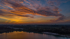 Aireal Over Pond - 072018-060814 (Glenn Anderson.) Tags: mavicpro drama drone outdoor sky cloud skyscape solar dramatic morning cloudsstormssunrisesandsunsets clouds sunrise trees lake pond reflection landscape aerialphotography