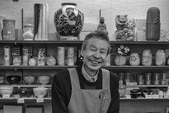 Shopkeeper in Yanaka Ginza (Guy: Jussum Guy) Tags: monochrome blackandwhite tokyo japan nippori yanaka yanakaginza shop pottery glassware shopkeeper portrait