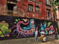 Among fantasy creatures (ingcuevas) Tags: paint painting wall mural graffiti beautiful awesome artistic inspiration bright vibrant colorful colors people street building boys walk fantasy ancient creature creativity