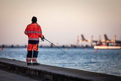 Fishing After Work (Mabry Campbell) Tags: europe malmö scandinavia skane skåne sweden coastal fisherman fishing harbor image malmo man mrina person photo photograph photography sport f28 mabrycampbell march 2012 march12012 201203013720 200mm ¹⁄₂₅₀sec 100 ef200mmf28liiusm
