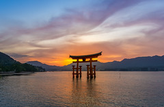 The Great Torii of Itsukushima (Tom Neumann) Tags: sony a6000 12mm samyang sky clouds colours sunset twilight sea ocean torii japan itsukushima miyajima water culture tradition trip travel mountains light lighting nightfall iluminacion luz viaje tradicion cultura japon crepusculo colores nubes
