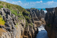 The Gap (Ron Scubadiver's Wild Life) Tags: newzealand pancake rocks nikon 24120 landscape sea water sky clouds surf outdoor