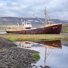 Garðar BA 64 (kaifr) Tags: garðarba64 rusted ship water dilapidated beached ashore nautic reflection fallingapart westfjordsregion iceland is