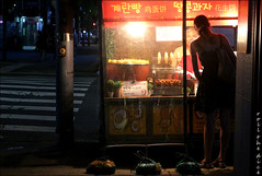 `2340 (roll the dice) Tags: southkorea korean streetphotography asia asian mad sad fun funny happy people fashion seoul holiday fareast night lights dark shops shopping canon tourism tourists portrait candid strangers urban unaware unknown food eat won hangul hanriver bored tmoney transport hot jongno pretty girl eyes eggbread crossing money snack bargain street button