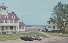 """UP Grand Marais MI c.1960s USLSS USCG Lifesaving Station & Range Marker early on Lifeboats launched in the calmer waters of the bay then rowed around into the rougher surf of Lake Superior2 (UpNorth Memories - Donald (Don) Harrison) Tags: vintage antique postcard rppc """"don harrison"""" """"upnorth memories"""" upnorth memories upnorthmemories michigan history heritage travel tourism restaurants cafes motels hotels """"tourist stops"""" """"travel trailer parks"""" cottages cabins """"roadside"""" """"natural wonders"""" attractions usa puremichigan """" """"car ferry"""" railroad ferry excursion boats ships bridge logging lumber michpics uscg uslss"""