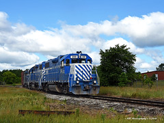 Clouds and EMD's in Cadillac (GRNDMND) Tags: trains railroads greatlakescentral locomotive emd gp382 calillac michigan