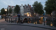 Amsterdam. (alamsterdam) Tags: amsterdam evening canal longexposure photographer bridges reflections people bikes sky clouds cars geotagging