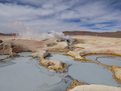 Geysers at Sol de Manana, Bolivia (Skoda Girl) Tags: geysers hot mud pools steam vents sulphur volcanic geological geology nature landscape water clouds blue white rocks yellow sol de manana bolivia south america