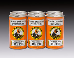A 6 pack of beer cans commemorating Mandan and Morton County North Dakota's 1981 centennial celebration.  The beer was brewed by the August Schell Brewing Company of New Ulm, Minesota (thstrand) Tags: 6pack 6packs sixpack can cansofbeer american alcohol alcoholicdrink 1880s 1881 1980s 1981 20th century aluminum augustschellbrewingcompany beers beverage brewed brewery celebration celebrations centennial centennials commemorate commemorative commemoration customsandtraditions drinking graphic design historic artifact artifacts history northdakota nd nodak midwest midwestern state label isolated labels mandan metal container containers morton county orangecolor specialty studio unitedstatesofamerica usa us vintage old