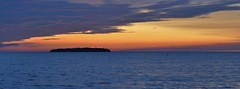Sunset over Horseshoe Island and Green Bay (stevelamb007) Tags: wisconsin greenbay doorcounty ephraim sunset island water clouds stevelamb nikon d90 nikkor 50mmf18 dusk horseshoeisland