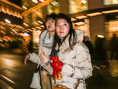 Point-and-Flash #001 (Never Edit) Tags: street photography streetphotography outdoor outside people peopleinthestreet strada city urban candid color colour realstreetphotography purestreetphotography rawstreet canpubphoto flash light trails lighttrails christmas winter shopping asian girls