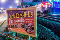 Junk Cars-R-Us (sullivan1985) Tags: newjersey nj arrowiii arrow jerseyarrows essexcounty morrisessex me commuter commutertrain passenger passengertrain junk sign billboard train night railway railroad