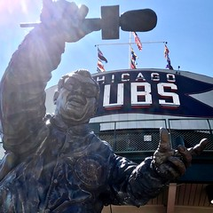 """""""Give me a C!"""" Harry Caray (statue) puts the C in Chicago Cubs at Wrigley Field. (LauraGilchrist4) Tags: everybodyin majorleaguebaseball theletterc budweisersign budweiser sign mlb c cubs chicago chicagocubs harrycaray formacwithyourarms wrigley wrigleyfield microphone bleachers stadium baseball announcer statue harrycaraystatue harry caray holycow neonsign flags baseballstadium baseballhistory"""