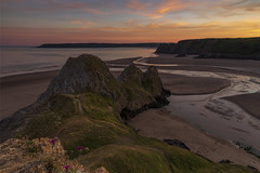 End of the day at three cliffs (jebob) Tags: wales jebob sunset coast beach cliffs sky sand rocks seascape landscape uk clouds gower swansea